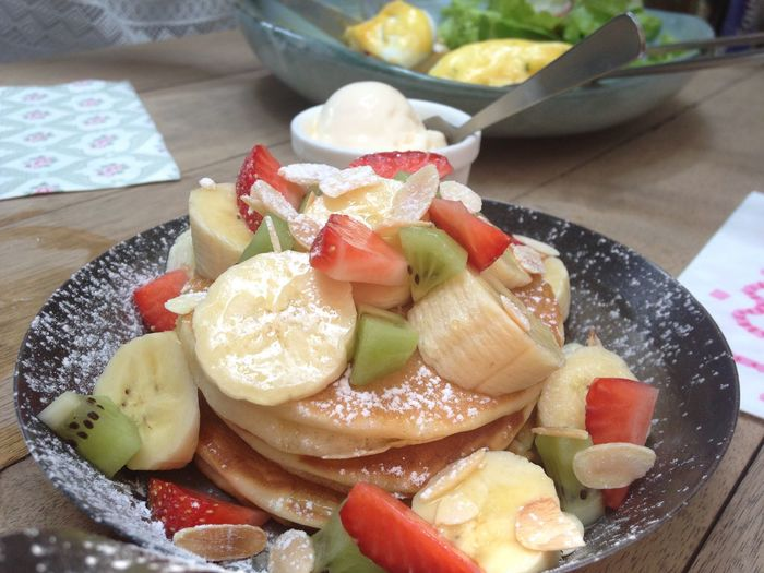 pancake with many fruit such as strawberry,kiwi,banana with icing or powder sugar ,almond sliced and maple syrup in restaurant Clean Eating Strawberry Ice Cream Food Cafe Breakfast Brunch Sweet Honey Maple Syrup Cafe Coffee Shop Cafe Fruit Pancake Pancakes Food And Drink Healthy Eating Freshness Ready-to-eat Close-up Fruit Serving Size Table Plate Dairy Product Banana