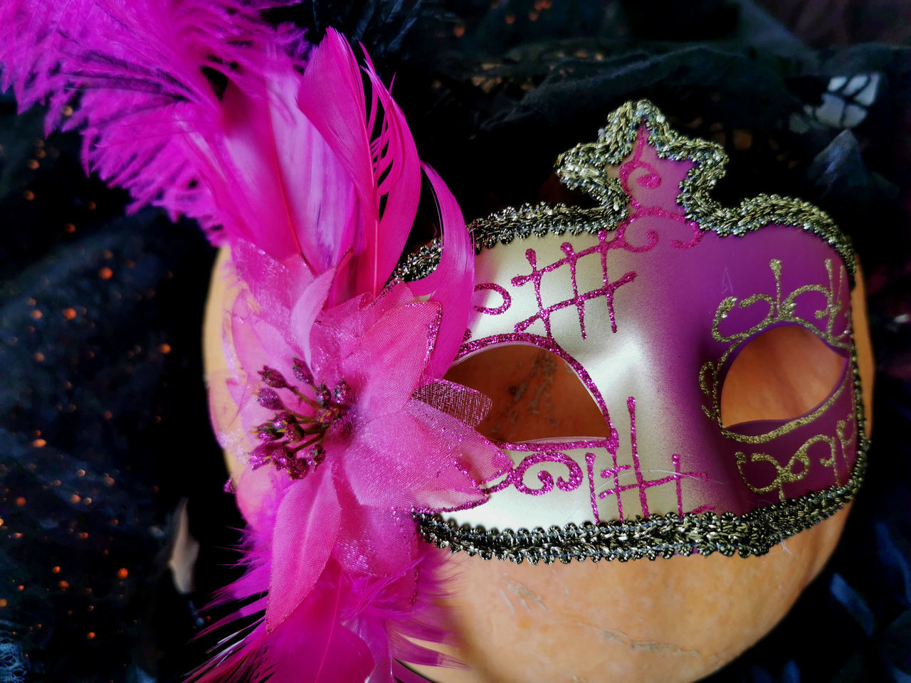 pink color, close-up, focus on foreground, no people, flower, flowering plant, day, nature, art and craft, mask, beauty in nature, creativity, outdoors, disguise, plant, representation, mask - disguise, human representation, costume, vulnerability, purple, carnival - celebration event