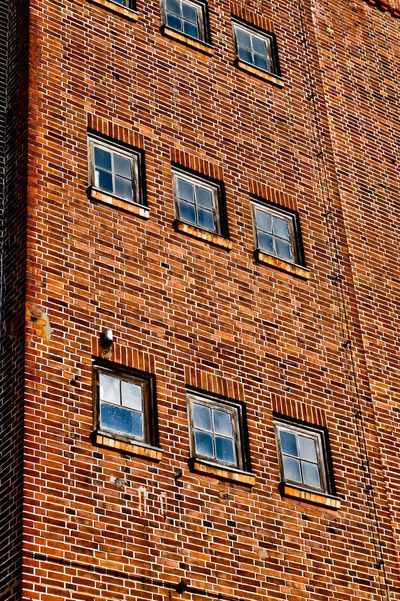 Architecture Backgrounds Blue Wave Brick Brick Wall Building Building Exterior Built Structure Day Full Frame House Low Angle View No People Outdoors Pattern Repetition Residential Building Residential Structure Showcase: April Wall Wall - Building Feature Window