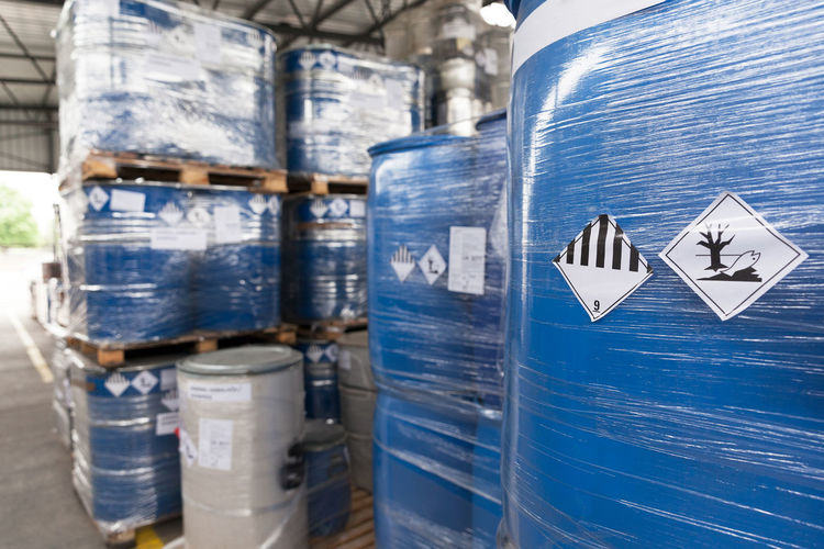Hazardous materials storage. Hazardous waste packaging Barrels Close-up Containers Danger Disposal Drum Hazardous Health Hoist Industry Lifter Materials Pollution Recycling Toxic Transportation Waste