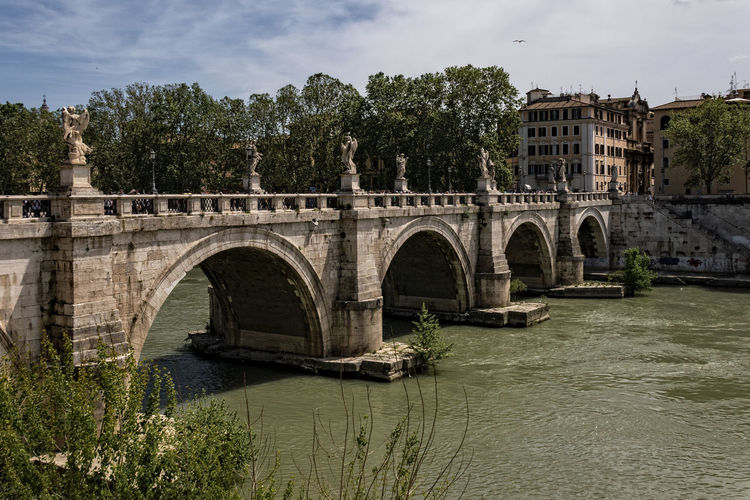 St. Angelo Bridge May St. Angelo Bridge Tiber River Arch Arch Bridge Arched Architecture Bridge Bridge - Man Made Structure Building Exterior Built Structure Connection Day Figures Nature No People Old Bridges Old Building  Outdoors Plant River Sky Statues Transportation Tree Water Waterfront