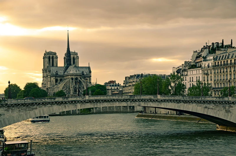 Dramatic sunset over paris. notre dame cathedral as background.