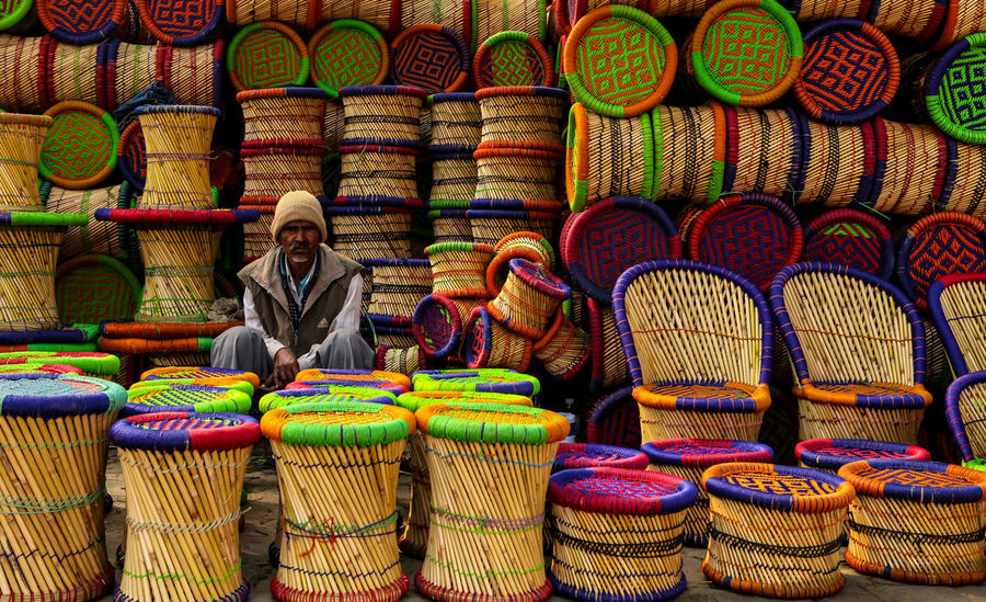 Multi Colored Choice Retail  Variation Business Finance And Industry Arrangement Large Group Of Objects For Sale Store Market Day Chairs Stools Shop Market Man Man At Work Shopkeeper Arranged Cultures India Utterpradesh