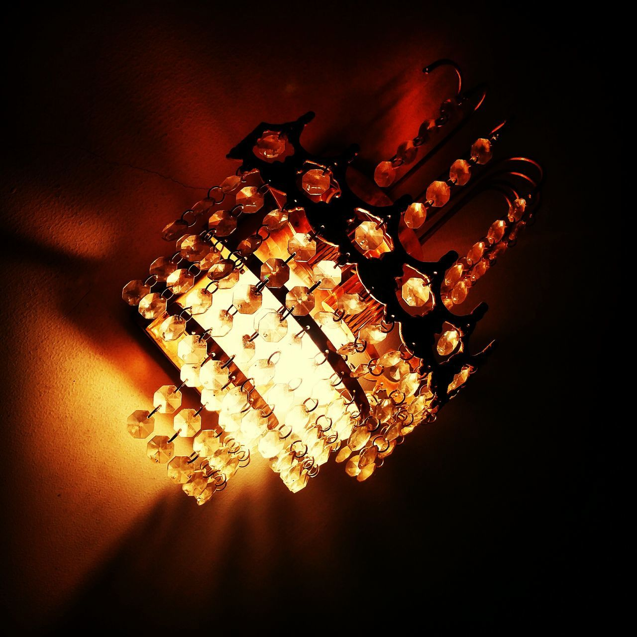 Low Angle View Of Illuminated Lighting Equipment In Room