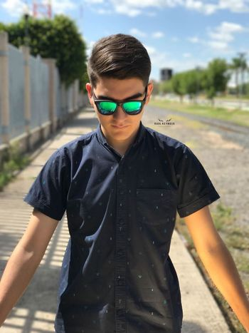 Sunglasses Boys Real People Outdoors Childhood Front View Day Subglasses Gafas De Sol  Gafas Hombre Model Models One Person Casual Clothing Lifestyles Happiness Leisure Activity Standing Smiling Sky Eyeglasses  Portrait One Boy Only Young Adult