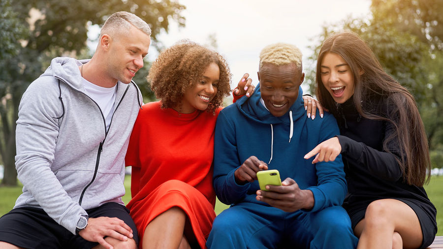 Group of friends sitting on smart phone