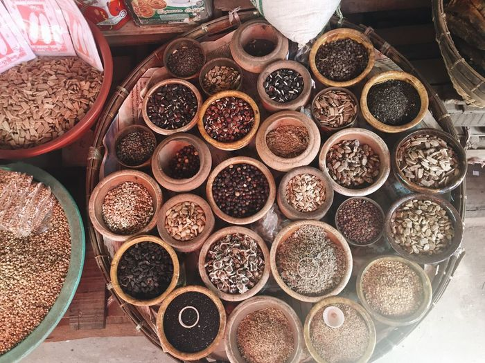 High Angle View Of Various Spices In Bowls At Store