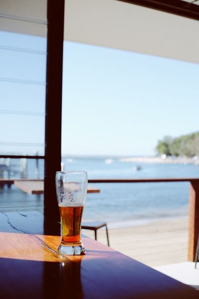 bye summer Summer Views Summer BeachsideRestaurant Beachside Holiday Glass Drinking Glass Sky Day Sea Focus On Foreground No People Nature Alcohol Outdoors Window Still Life Household Equipment