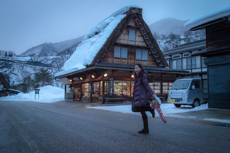 She is happy Japan Shirakawago Travel Photography Cold Temperature Winter Architecture Snow One Person Building Exterior Built Structure Building City Road Adult Lifestyles Nature Outdoors Mountain