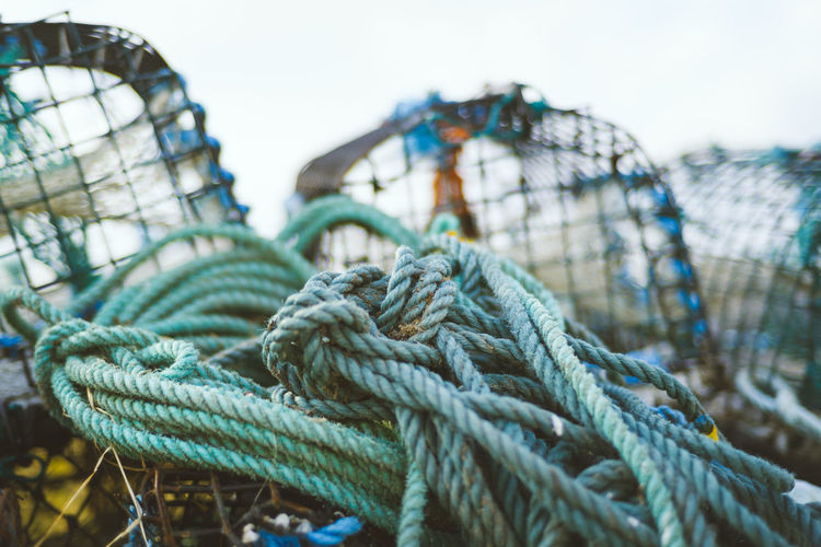 Close-up of tied rope and crab pots