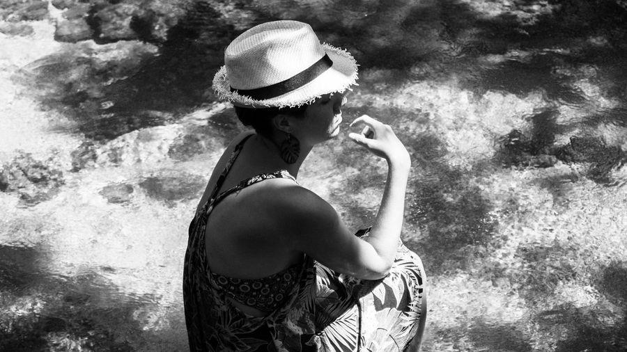 Side view of woman wearing hat