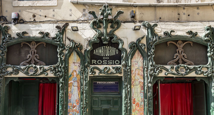 Facade of the 1907 cinema adorned in Art Nouveau style with tiled panels depicting Edwardian styled females surrounded by fruits and flowers in Lisbon, Portugal. Façade Rossio Square Architecture Art Nouveau Auditorium Building Exterior Built Structure Cinema Close-up Edwardian Female Flowers Fruits No People Outdoors Tiles First Eyeem Photo
