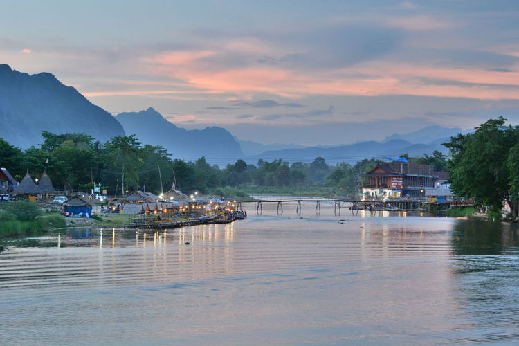 Nam river at dusk. Vang Vieng. Vientiane province. Laos Asian  Beauty In Nature Dusk Dusk Colours Landscape Laos Mountain Range Nam River Nature No People Outdoors River River View Riverside Rural Scene Scenics Sunset Tourism Tranquility Travel Destinations Vang Vieng Vang Vieng, Laos Vientiane Province Water Waterfront