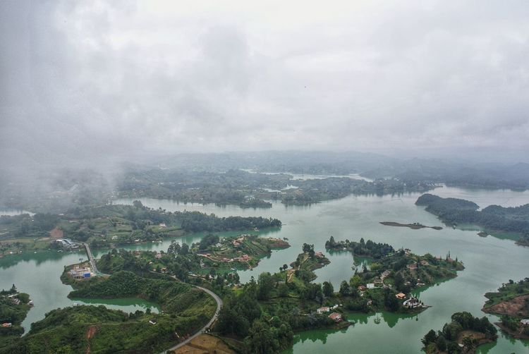 Guatape. 🇨🇴 Flooded Quechua Travel Nature Nature Photography Nature_collection Antioquia South America Latin America Landscape Monolith Mirador La Piedra Del Penol From Where I Stand Guatape Medellín Colombia Colombia ♥  Tree Rural Scene Fog Water Agriculture Lake High Angle View Sky Architecture Valley Hill Aerial View
