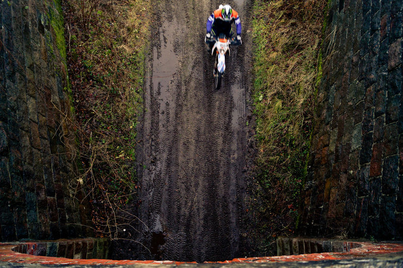 High angle view of motocross rider from bridge