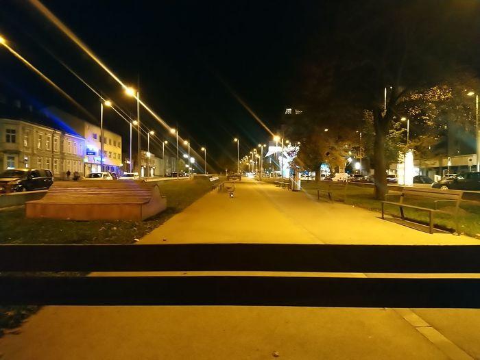 Cars on illuminated bridge at night