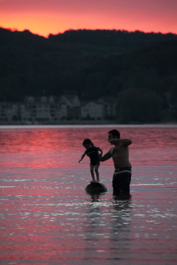 Sunset Silhouettes Father And Daughter Helping Hand Tranquil Scene Tranquil Waters Lake Michigan Summer Summer Vacation Pink Color Pink Horizon