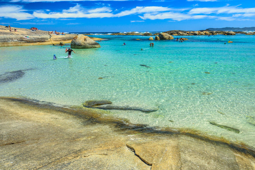 Calm and sheltered waters of Greens Pool in William Bay National Park, Denmark, Western Australia. People swimming in summertime. Popular travel destination in Australia. Australia Western Australia Beach Sea Sea And Sky Bay Sunbathing Sand Shore Rocks Boulder Blue Sky People Tourist Travel Destinations Summer Madfish Beach William Bay National Park Elephant Rocks Greens Pool Coastline Great Southern Ocean Ocean View Waterfall Beach Denmark Water Land Beauty In Nature Nature Scenics - Nature Sky Day Holiday Vacations Trip Blue Incidental People Lifestyles Tranquility Real People Leisure Activity Cloud - Sky Turquoise Colored Outdoors