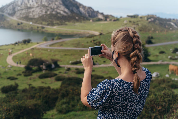Woman photographing on mobile phone