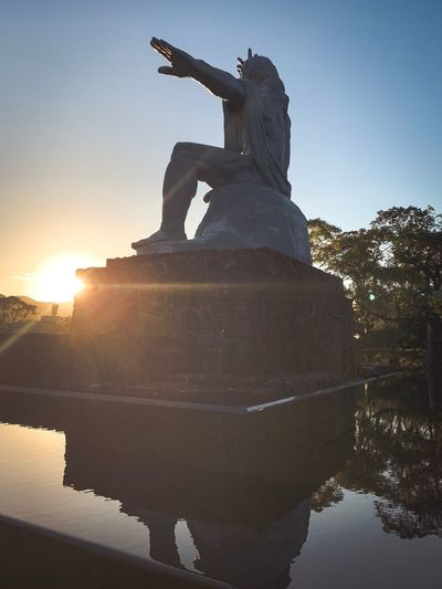 ShotOnIphone Japan Nagasaki Sky Sunset Water Sunlight Nature Sun Architecture Statue Sculpture No People Human Representation Built Structure The Past Lens Flare Outdoors Representation History Reflection Sunbeam Clear Sky