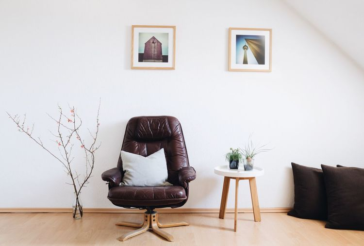 Empty Living Room With Luxurious Chair Against Wall