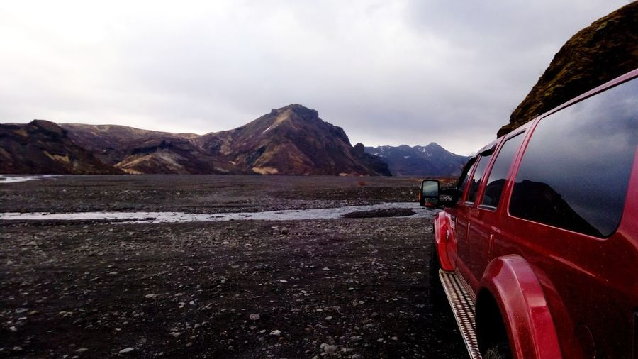 Amazing panorama close to Eyjafjallajökull in South Iceland Iceland Volcano Volcanic Landscape Iceland_collection Iceland Memories EyeEm Selects Photography Panorama Sky And Clouds Mountains Mountains And Sky Waterfalls Mountain Desert Red Snow Car Road Trip Sky Landscape Mountain Range 4x4 Vehicle Hood Vintage Car Land Vehicle Off-road Vehicle Car Point Of View Windshield Snowcapped Mountain Parking
