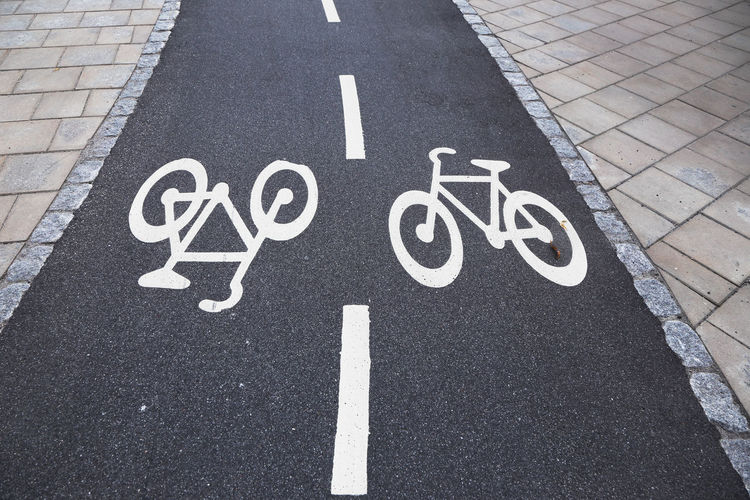 Bidirectional bicycle lane with markings. Sweden Asphalt Bicycle Bicycle Lane Bidirectional Black Communication Guidance High Angle View Imbedded No People Outdoors Road Road Marking Road Sign Street Symbol Track Transportation White