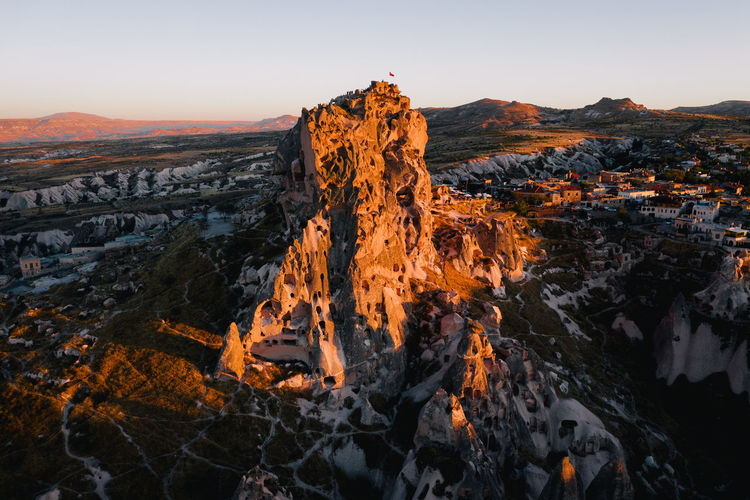 Sunset light hits the incredible Uchisar Castle in Cappadocia, Turkey. Week On Eyeem Sky Mountain Rock Beauty In Nature Scenics - Nature Nature Rock - Object Sunset Environment No People Rock Formation Physical Geography Geology Landscape Mountain Range Outdoors Turkey Cappadocia Uçhisar Castle Travel Dji Drone Photography Aerial Photography Autumn Mood