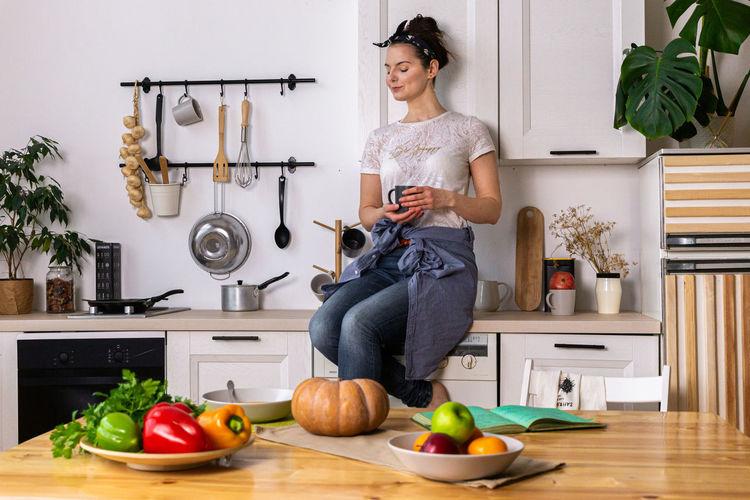 Woman eating food at home