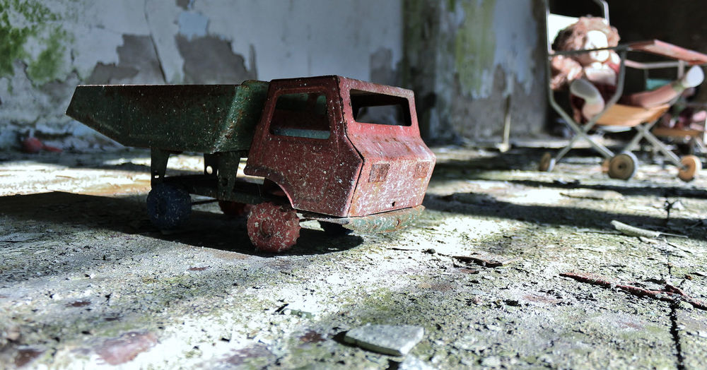 Close-up of old toy in abandoned house