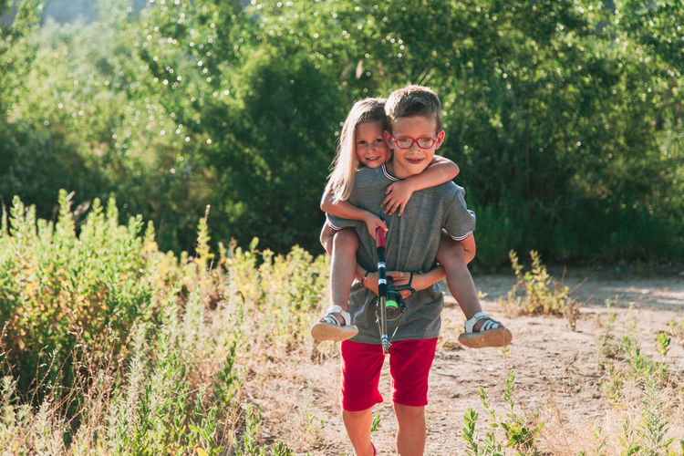 Bonding Boys Carrying Child Childhood Day Emotion Family Happiness Innocence Love Males  Men Nature Outdoors Parent Plant Positive Emotion Smiling Son Three Quarter Length Togetherness Two People