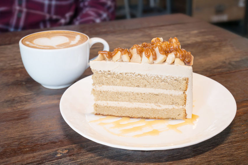 Macadamia caramel cake Nuts Cake Caramel Close-up Coffee - Drink Coffee Cup Cream Dessert Drink Focus On Foreground Food Food And Drink Freshness Indoors  Indulgence Macadamia No People Plate Ready-to-eat Serving Size Still Life Sweet Food Table Temptation Unhealthy Eating