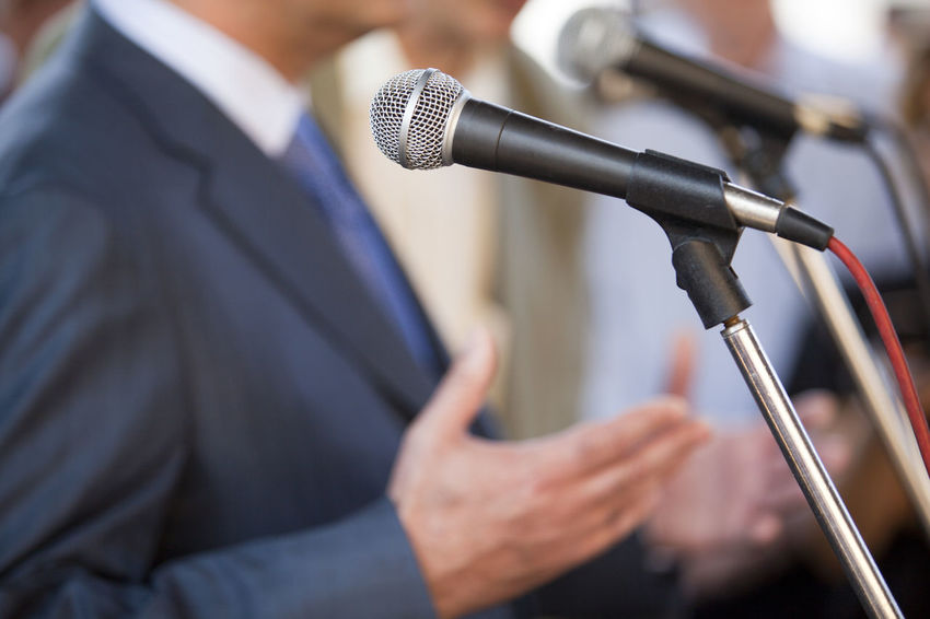 Speech Event PR Promotion Speech Announcement Business Businessman Campaign Rally Communication Hand Gesture Information Marketing Media Event Microphone News Conference Politician Politics Press Conference Public Relations Publicimage Publicity Real People Selfpromotion Speaker Speaking