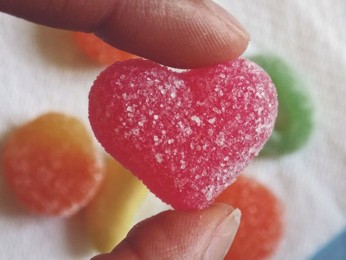 Love Sweet Sweet Food Heart Heart Shape EyeEm Best Shots Taking Photos Taking Pictures Colors Color Colorful Human Hand Nail Polish White Background Multi Colored Candy Red Flavored Ice Holding Candy Heart Dessert Candy Store Sprinkles Sugar