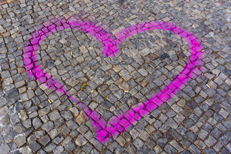 Close-Up of Pink Heart Painted on Cobblestone Road Berlin Germany 🇩🇪 Deutschland Color Image Outdoors No People Heart Shape Love Positive Emotion Creativity Pink Color Art And Craft Street Emotion Cobblestone High Angle View Footpath Day City Close-up Graffiti Design Pattern Paving Stone Message Craft