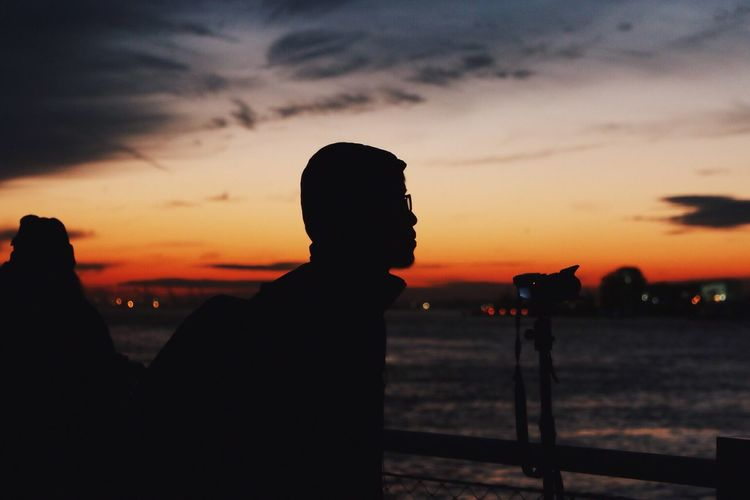 Silhouette Of Man Against Sky At Sunset
