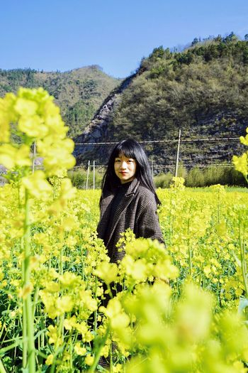 Spring Flower Traveling In China Plant Real People Looking At Camera Nature Land Leisure Activity One Person Portrait Growth Green Color Lifestyles Beauty In Nature Field