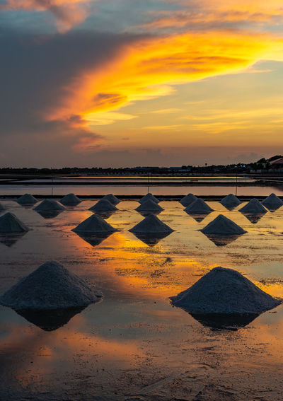 Salt in the salt fields in the evening during the shoveling of salt