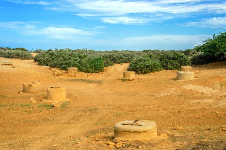 Wells in a desert in La Guajira, Colombia used for water by the indigenous Wayuu City Colombia Country Countryside Day Desert Dry Earth Environment Ground Guajira Laguajira Land Landscape Nature Nobody Outdoors Outside Rural Scene Summer Town Tree View Well