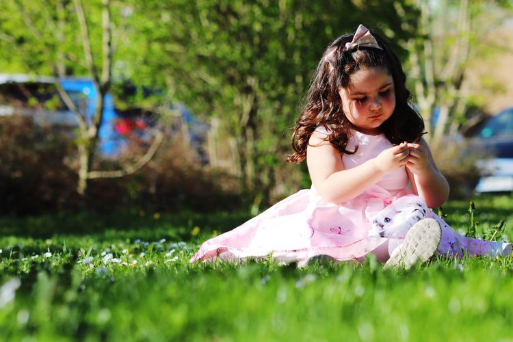 cut girl on grass Cute Nature Tree Green Green Color Child Childhood Full Length Girls Playing Curly Hair Cute Sitting Grass Babyhood Baby Tutu