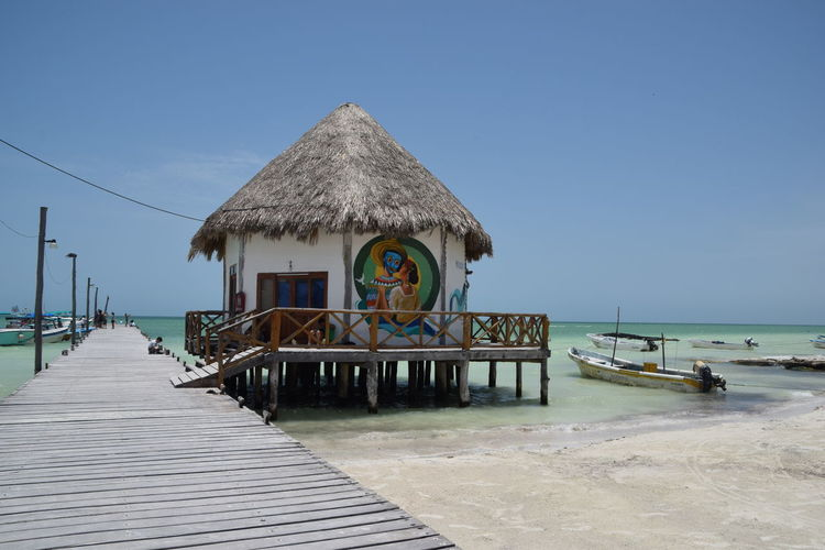 holbox, mexico Holbox Island Holbox The Paradise Mexico Architecture Beach Beauty In Nature Blue Building Building Exterior Built Structure Clear Sky Day Direction Footpath Holbox Land Nature No People Outdoors Sea Sky Thatched Roof The Way Forward Water Wood - Material