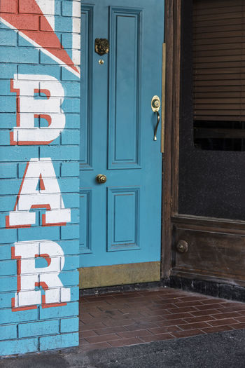 Architecture Bar - Drink Establishment Bar Sign Blue Color Brick Wall Building Exterior Built Structure Close-up Day Door Entrance Front Door House No People Outdoors Painted Painted Signage