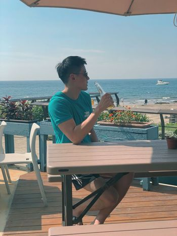 Beer by the beach Beer - Alcohol Beer Sea Real People Sky One Person Sitting Leisure Activity Lifestyles Horizon Over Water Casual Clothing Outdoors Beauty In Nature Chair Young Adult Table Day Sunlight Horizon Nature Seat