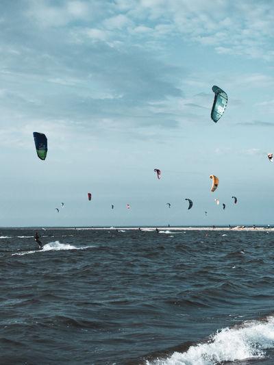 Kitesurfers at the rough bay