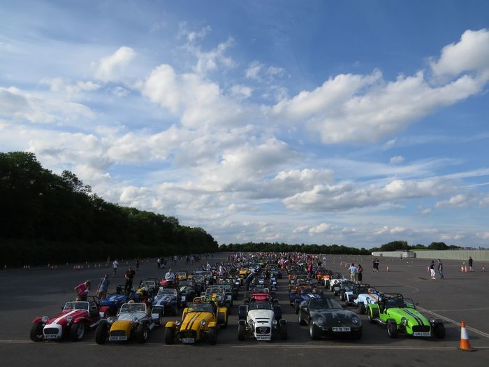 grid of caterham super sevens participating at the parade lap in donington park for the 60th birthday of lotus sports cars 60th Birthday Lotus Cars Car Caterham Super Seven Cloud - Sky Day Land Vehicle Mode Of Transport Nature No People Outdoors Parade Lap Sky Transportation Tree