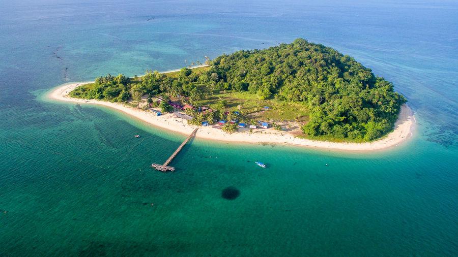 Tropical rusukan besar island with crystal clear water and sandy beach in labuan island,malaysia.