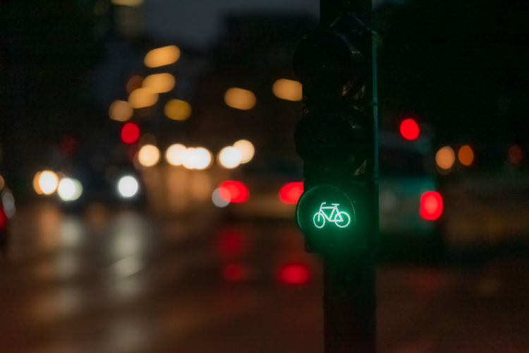 Close-up of road signal at night