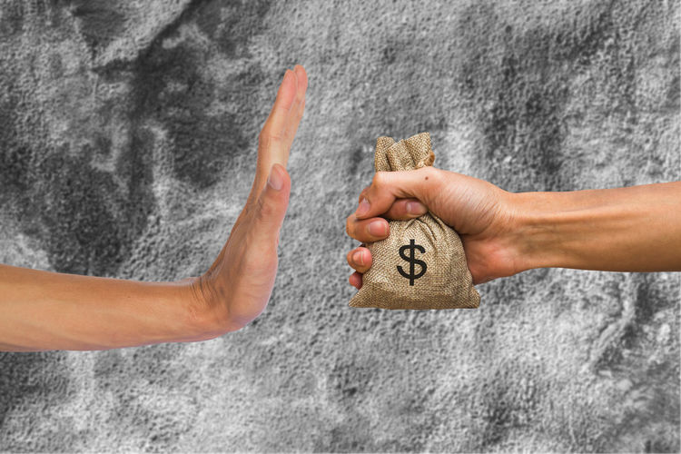 A hands holding money bag and rejecting hand to receive money of another person on concrete wall background. Conceptual stop corruption. Corruption reject concept. Adult Body Part Close-up Communication Corruption Finger Gray Hand Holding Human Body Part Human Hand Limb People Reject Togetherness Two People Women