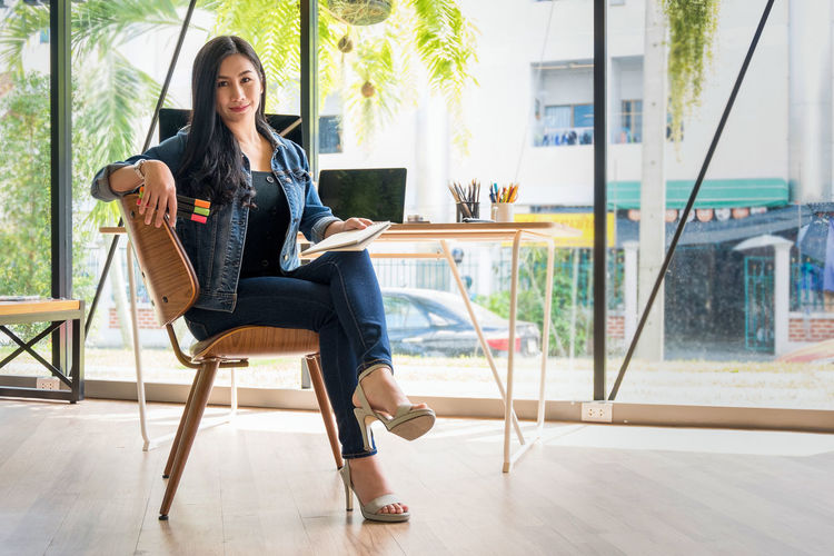Portrait of businesswoman sitting on chair in office