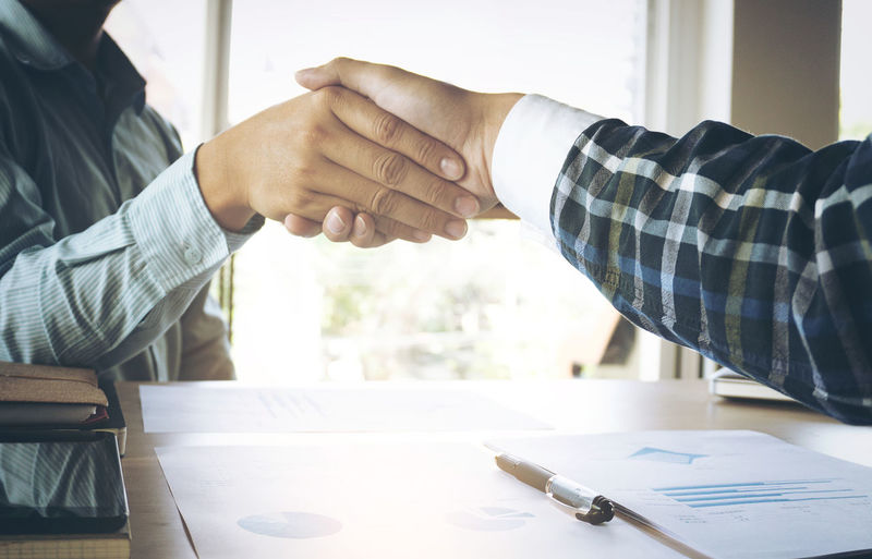 Business Collaboration Planning Shaking Agreement Bonding Business Businessman Close-up Cooperation Desk Executive  Friendship Handshake Human Hand Indoors  Investment Marketing Men Shake Strategy Teamwork Togetherness Two People Well-dressed